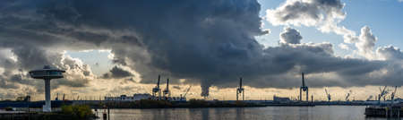 Panoramic view of port of Hamburg from Hafencity before sunset with dramatic stormy clouds Standard-Bild