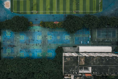 Aerial overhead drone shot of basketball and football field at middle school in Chongqing, southwest China Foto de archivo