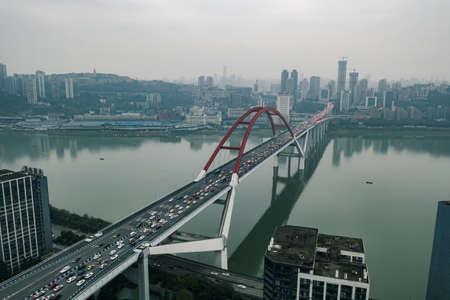 Aerial drone shot of Caiyuanba Changjiang bridge on Yangtze River in Chongqing, southwest China metropolis