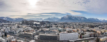 Panoramic aerial drone shot view of Salzburg aiglhof station with view of eastern bavarian alps mountain in winter time
