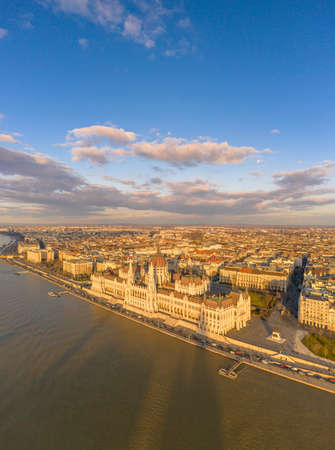 Aerial drone view of Hungarian Parliament by Danube river in Budapest sunset hour in winter
