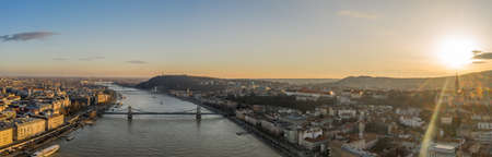 Panoramic aerial drone view of Danube River Buda Castle and Buda hill in Budapest in sunset hour in winter