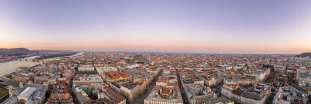 Panoramic aerial drone shot of downtown skyline in Budapest winter sunset time