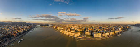 Wide panorama aerial drone view of Hungarian Parliament by Danube river in Budapest sunset in winter Stok Fotoğraf