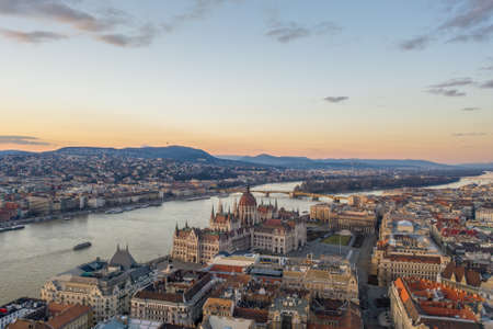 Aerial drone shot of Hungarian Parliament Kossuth Square by Danube river in Budapest sunset in winter time