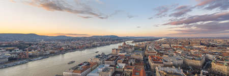Parnoramic Aerial drone shot of Hungarian Parliament Kossuth Square by Danube river in Budapest sunset in winter Stok Fotoğraf
