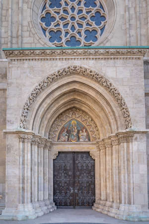West side entrance of Matthias church with Mary the Lady of the Hungarians in Budapest in winter 写真素材