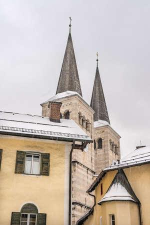Steeple of Stiftskirche St. Peter und Johannes der Taufer in Berchtesgaden, Germany with snow