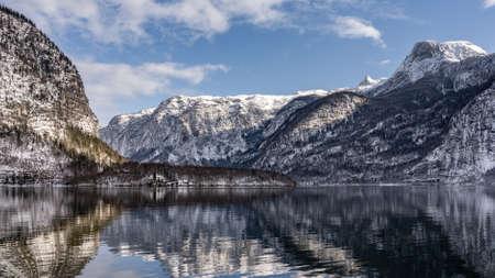 Pano view of snowy mountains pine trees around Austrian Schloss Grub in Obertraun by lake Hallstatt in winter