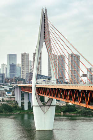 Qian si men suspension bridge tower over Jialing river