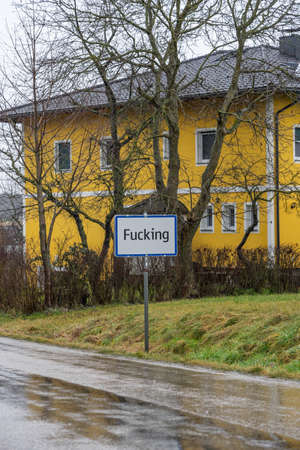 Feb 3, 2020 - Fucking, Austria: Weird offensive obscene Austrian town name plate in the country field outside yellow house in the rain