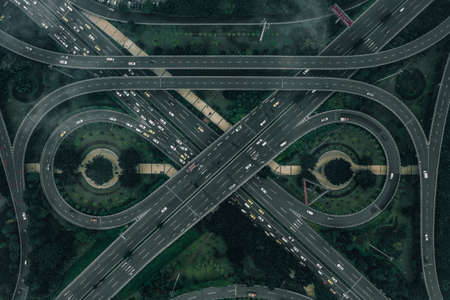 Aerial drone shot of flyover with heavy traffic in foggy gloomy weather in Chongqing, China