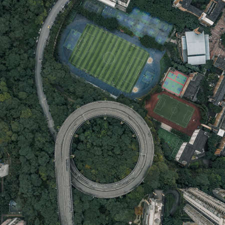Aerial overhead shot of particular double circle 720 degree flyover in bushes residential buildings in Chongqing, China