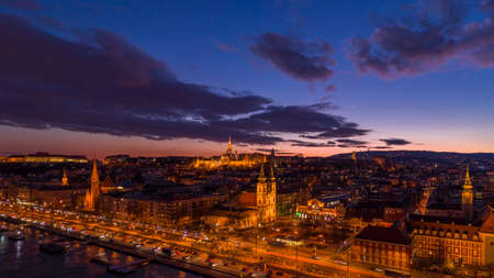 Panoramic aerial drone shot of Matthias Churh, St. Anne Church and market hall by Danube in Budapest sunset Stockfoto