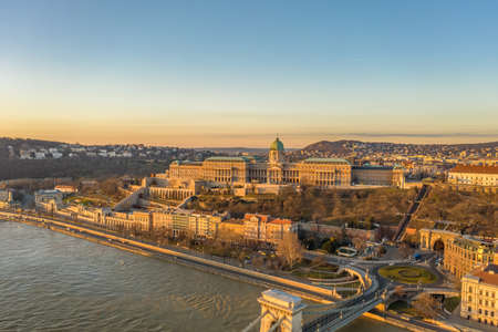 Aerial drone shot of Buda castle on Buda hill during Budapest sunrise morning glow Stockfoto - 151029332