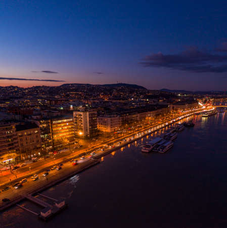 Aerial drone shot of Danube riverbank Buda hill side during Budapest sunset hour Stockfoto - 151029359