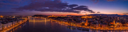 Panoramic aerial drone shot of lighted quai of Buda Hill by Danube in beautiful Budapest sunset Stockfoto - 151029414
