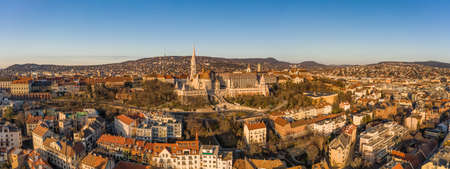 Panoramic aerial drone shot of Matthias churh on buda hill during Budapest morning sunrise Stockfoto - 151029455