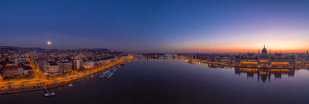 Panoramic aerial drone shot of Hungarian Parliament lights off sunrise in Budapest dawn Stockfoto - 151127523