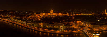 Panoramic aerial drone shot of Buda castle on Buda Hill in Budapest night with city lights on