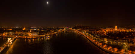 Panoramic aerial drone shot of Danube with moon National Gallery and chain bridge in Budapest night