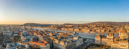 Panoramic aerial drone shot of Danube river with Buda castle and Hungarian Parliament in Budapest