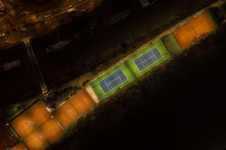 Aerial overhead night shot tennis light on courts of Neuilly Tennis Association on Ile de la Jatte in Paris France Stockfoto