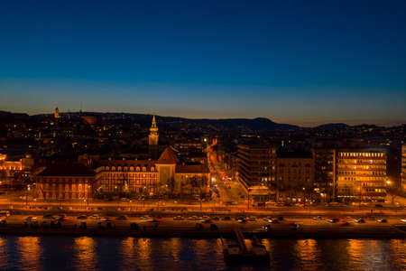 Aerial drone shot of St. Francis parish church by Danube in Budapest twilight