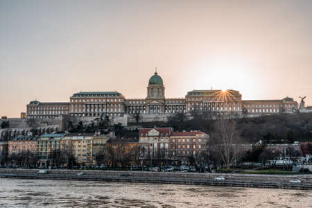 Buda castle on hill during sunset hour in Budapest winter