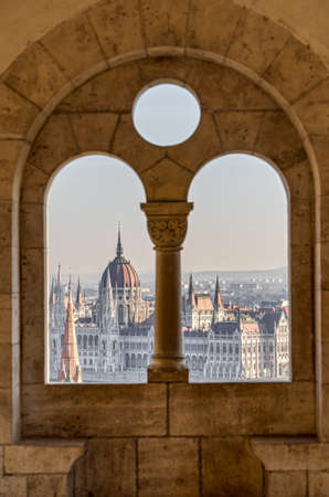 Hungary Parliament dome view through corridor column on fishermans bastion on Budapest ountain