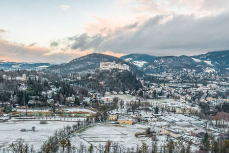 Aerial view of Hohensalzburg Fortress from southwest outskirts of Salzburg in Austria during winter