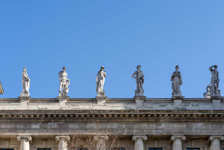 Allegorical sculptures of Attica on top left side of Museum of Ethnography in Budapest