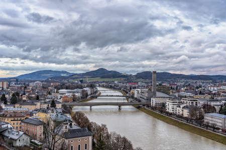 Salzach river through Sazburg town in winter in Austria