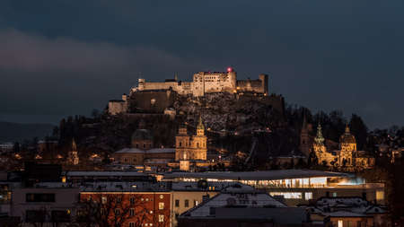 Festung hohensalzburg and Salzburg Cathedral with light on in th