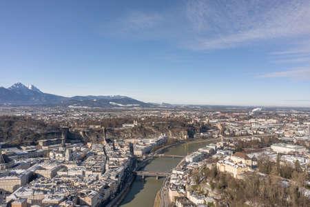 Aerial drone snowy view of northrn salzburg along Salzach river in winter morning Stockfoto