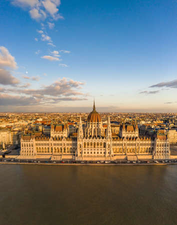 Aerial drone view of Hungarian Parliament facade by danube river Stockfoto
