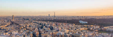 Aerial panorama drone shot of Neuilly sur Seine in Paris with Tour Eiffel Montparnasse Jardin acclimatation in Boulogne