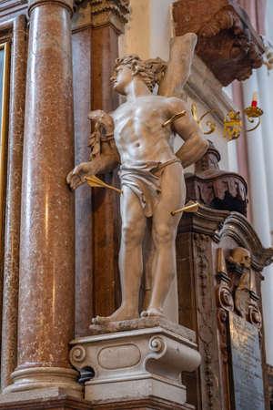 Marble statue at Stiftskirche St. Peter und Johannes der Taufer