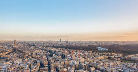 Aerial drone shot of districts Neuilly sur Seine in Paris with Tour Eiffel Jardin acclimatation in Boulogne forests