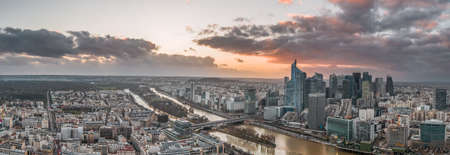 Panoramic aerial drone shot of Neuilly la defense skyscraper complex during sunset Stockfoto