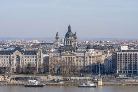 Gresham Palace with St. Stephens Basilica on Danube riverside in Budapest winter morning