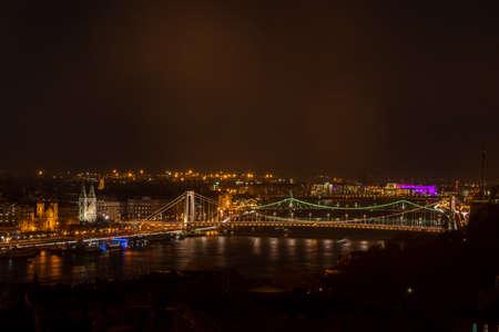 Budapest, Hungary - Feb 8, 2020: Inner City Parish Church and Elisabeth bridge above Danube river in the night
