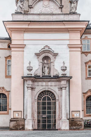 Feb 4, 2020 - Salzburg, Austria: Front facade of Abbey church with onion dome inside St Peter Abbey