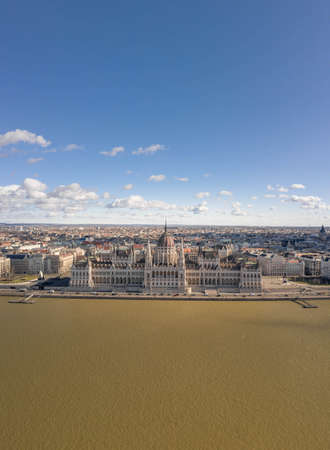 Aerial drone shot of Hungarian Parliament with clouds in Budapest Winter morning time