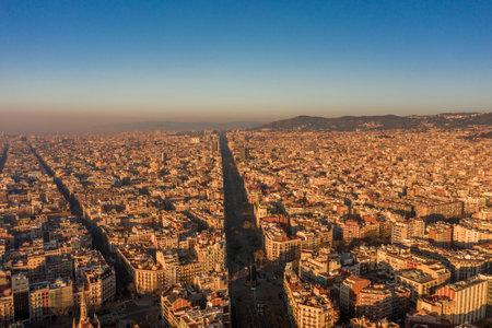 Aerial drone shot of .Avinguda Diagonal in Barcelona downtown in sunrise