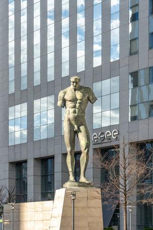 Paris, France - Jun 13, 2020: Bronze male body Sculpture Icare of Igor Mitoraj in La Defense