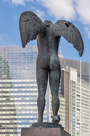 Paris, France - Jun 13, 2020: Bronze sculpture Ikaria before Tour Egee Regus in La Defense