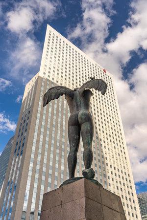 Paris, France - Jun 13,2020: Bronze sculpture Ikaria before Tour Egee Regus in La Defense Editorial