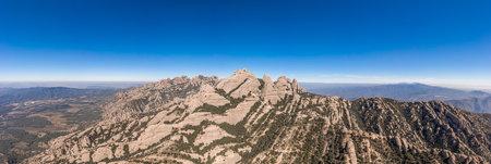 Panoramic aerial shot of Sant Jeroni Montserrat Peak near Barcelona