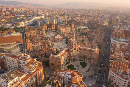 Aerial drone shot of Barcelona near Turo de la Rovira in morning sunrise